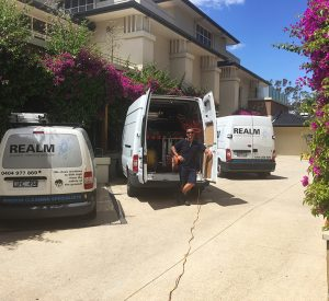 Realm Window Cleaning Vans at a Residential Building